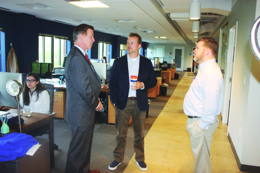 U.S. REP. DON BEYER began his day-long visit to Falls Church last Friday at the innovative Viget, where he was given a tour by co-owners Brian Williams and Andy Rankin. (Photo: News-Press)