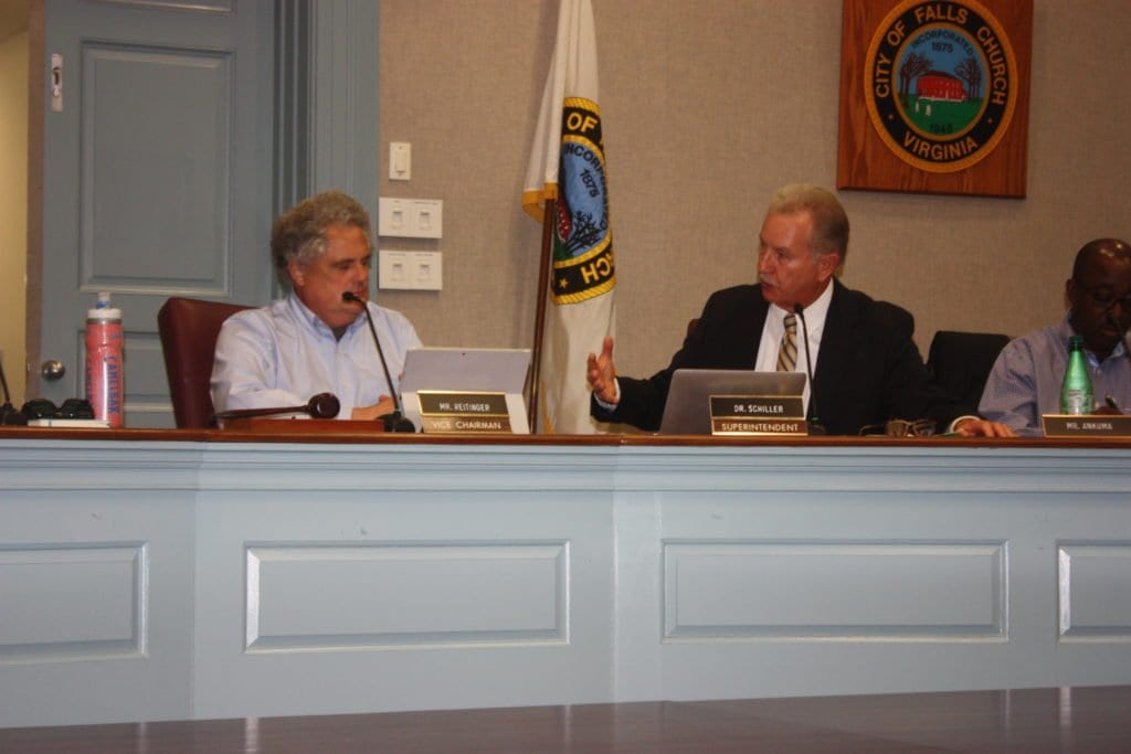 PHIL REITINGER (LEFT), ACTING chair of the Falls Church School Board Tuesday night, and Interim Superintendent Dr. Robert Schiller compared notes during Tuesday night's board meeting. (Photo: News-Press)
