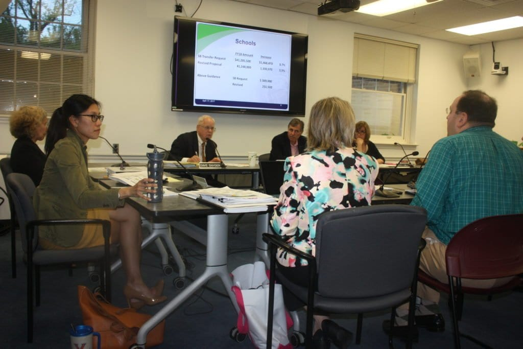 AT MONDAY NIGHT'S Falls Church City Council meeting, Assistant City Manager Cindy Mester and School Chief Financial Officer Hunter Kimball, with backs to the camera, come before three of the seven Council members present shown here, Letty Hardi (far left), David Snyder and Mayor David Tarter. (Photo: News-Press)