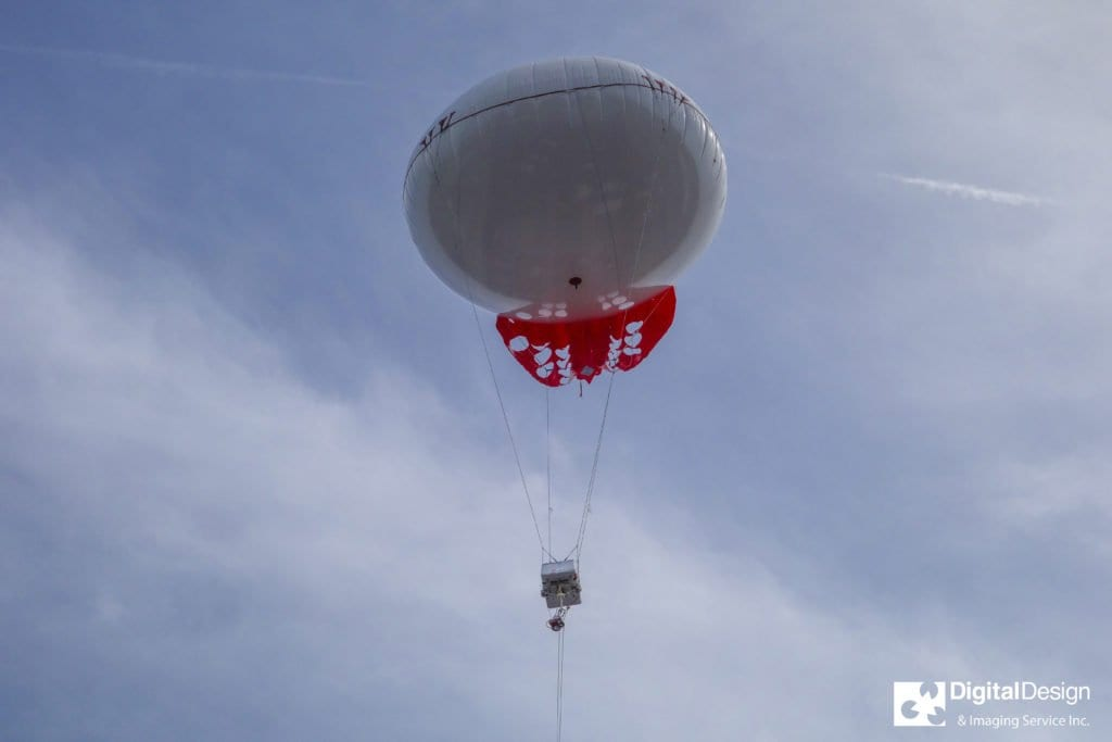 A DDIS custom-designed payload mount lofts cloud measurement sensors above the Falls Church shop.