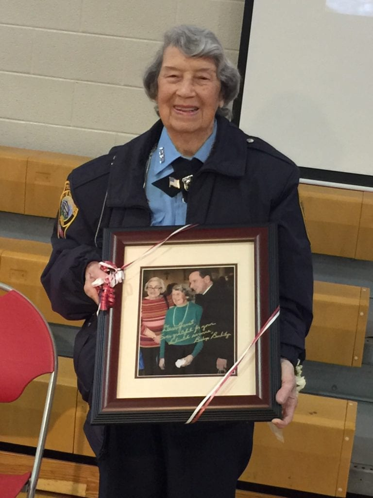 Haines poses with one of her many gifts, a photo of her with the bishop of the Catholic Diocese of Arlington, Michael F. Burbridge. (Photo: News-Press)