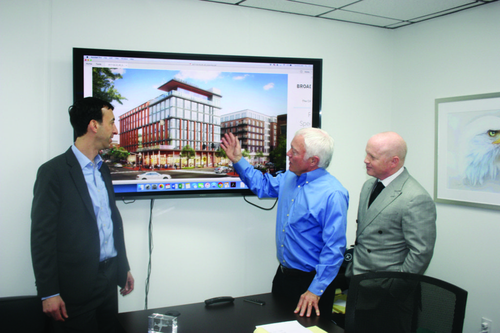 UNVEILING AN ARTIST'S RENDERING of their new Washington at Broad submission to the City of Falls Church are key players in the team effort, left to right, Maury Stern and Rick Hausler of the Insight Property Group and Todd Hitt of Kiddar Capital. (Photo:  News-Press)