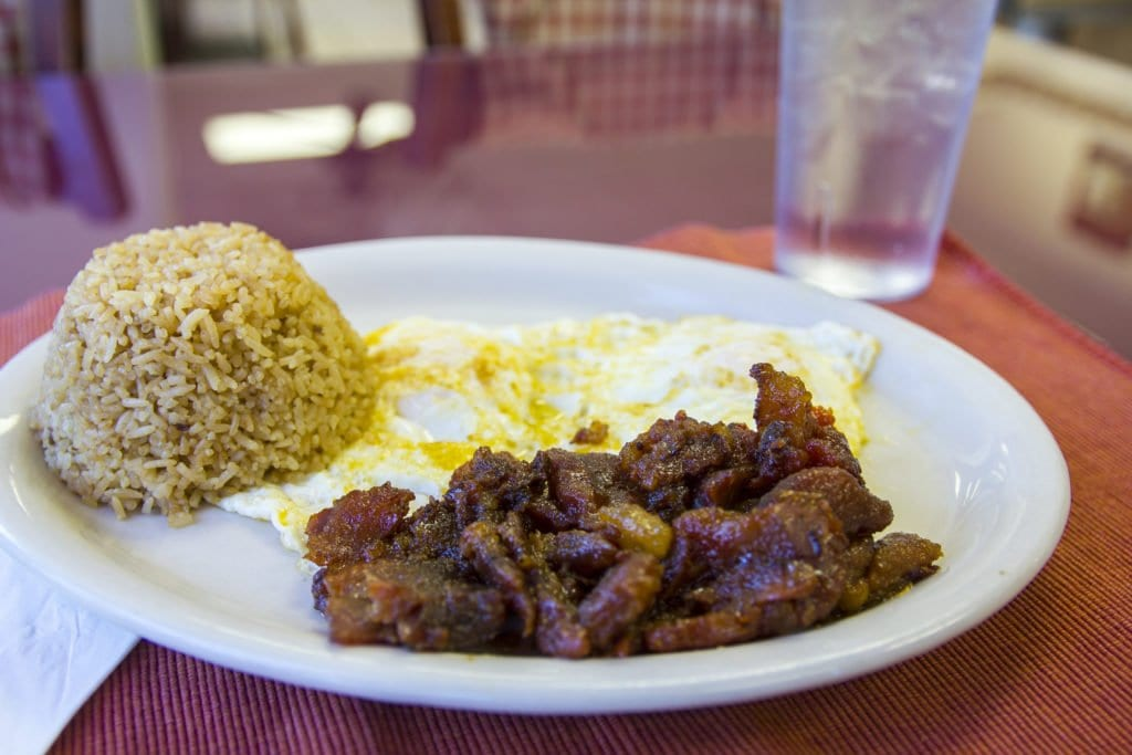 A plate of tosilog at Fairfax Inn Restaurant with tocino, two eggs and garlic fried rice.