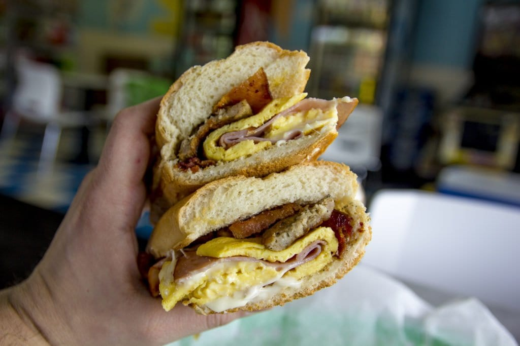MIke's Deli's Belly Buster stuffs a toasted sub roll with sausage, bacon, ham, eggs and cheese.