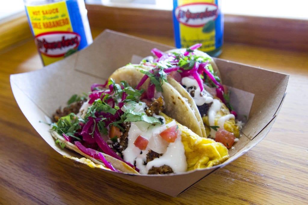 With breakfast all day, Taco Bamba's breakfast tacos jams chorizo, eggs, crema, guacamole and pico de gallo into a just-barely big enough tortilla.