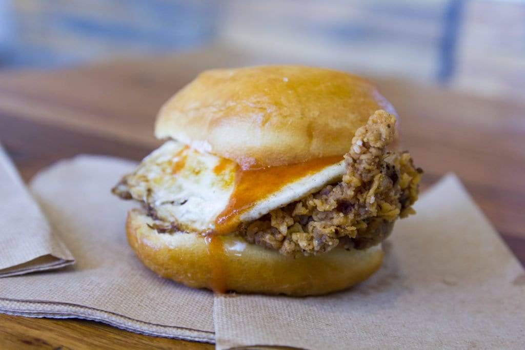 A honey butter and hot sauce-topped fried chicken sandwich, with an egg of course, from Astro.