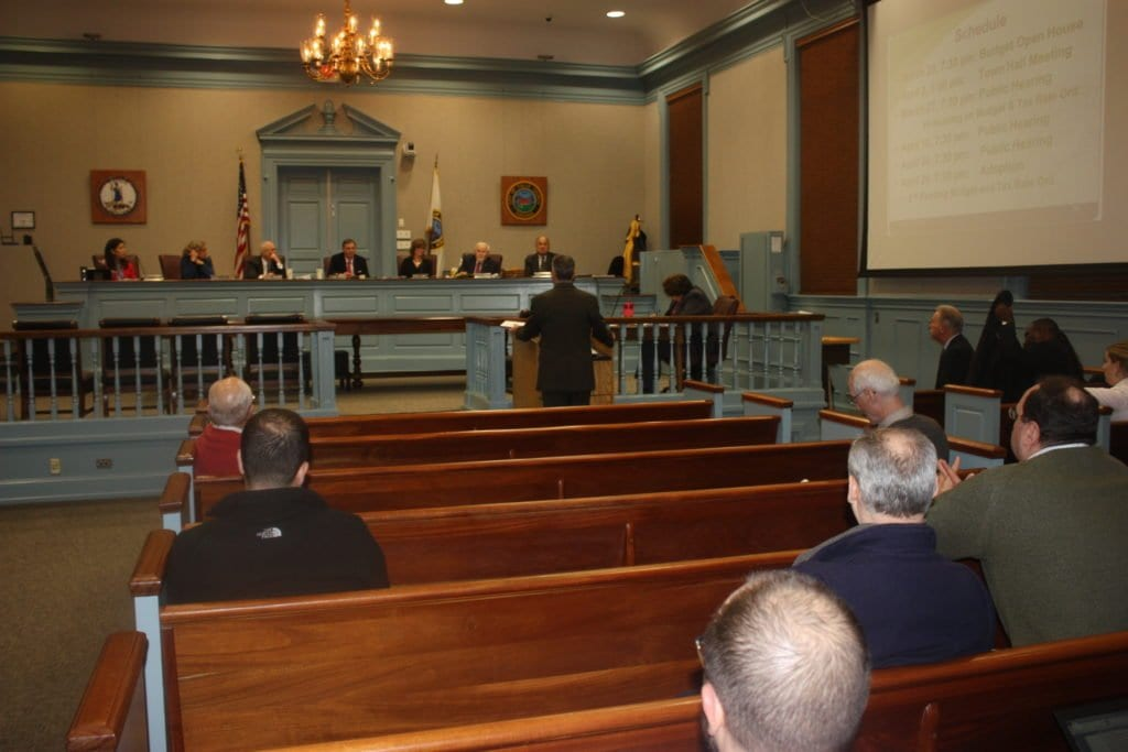 WITH FALLS CHURCH City Manager Wyatt Shields at the podium addressing the F.C. City Council on his FY18 budget recommendations, vocal concerns arose over its inclusion of a three cent increase on the tax rate to set aside funds to handle the prospective high cost of a new high school that will come before votes for approval in November. (Photo: News-Press)