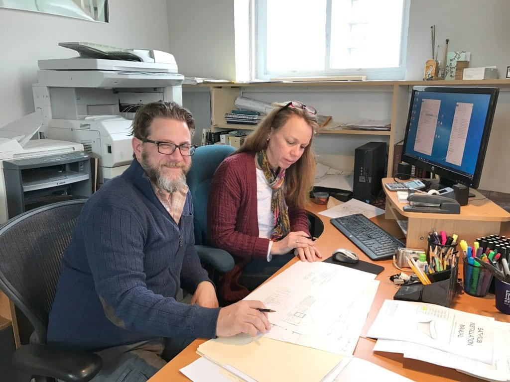 JEFF DUBRO AND FELLOW ARCHITECT Lucia Dunin-Borkowski reviewing a floorplan for one of their homes. (Photo: Jeff DuBro)