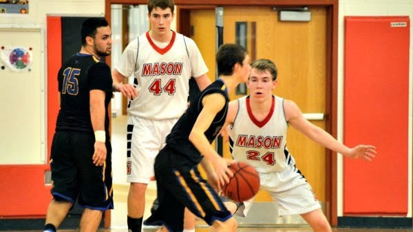 Mason's Thomas Creed (44) and Hollman Smith (24) lock in on defense against Central (Photo: Carol Sly)