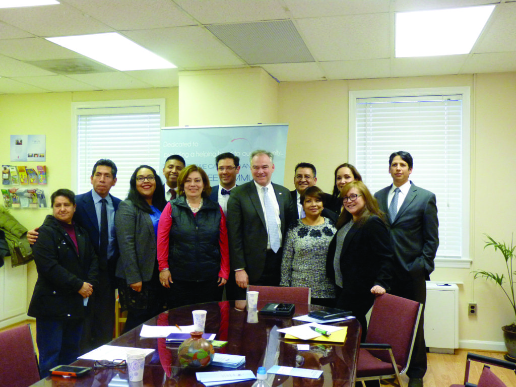 U.S. Senator Tim Kaine poses with members of the Latino healthcare community after a roundtable discussion at NoVaSalud in Falls Church last Friday. (Photo: News-Press)