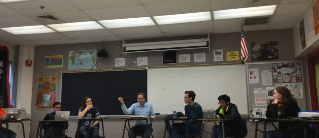 Third block Theory of Knowledge class, with Mr. Scharff lecturing about religious knowledge. (Photo: Kate Karstens)