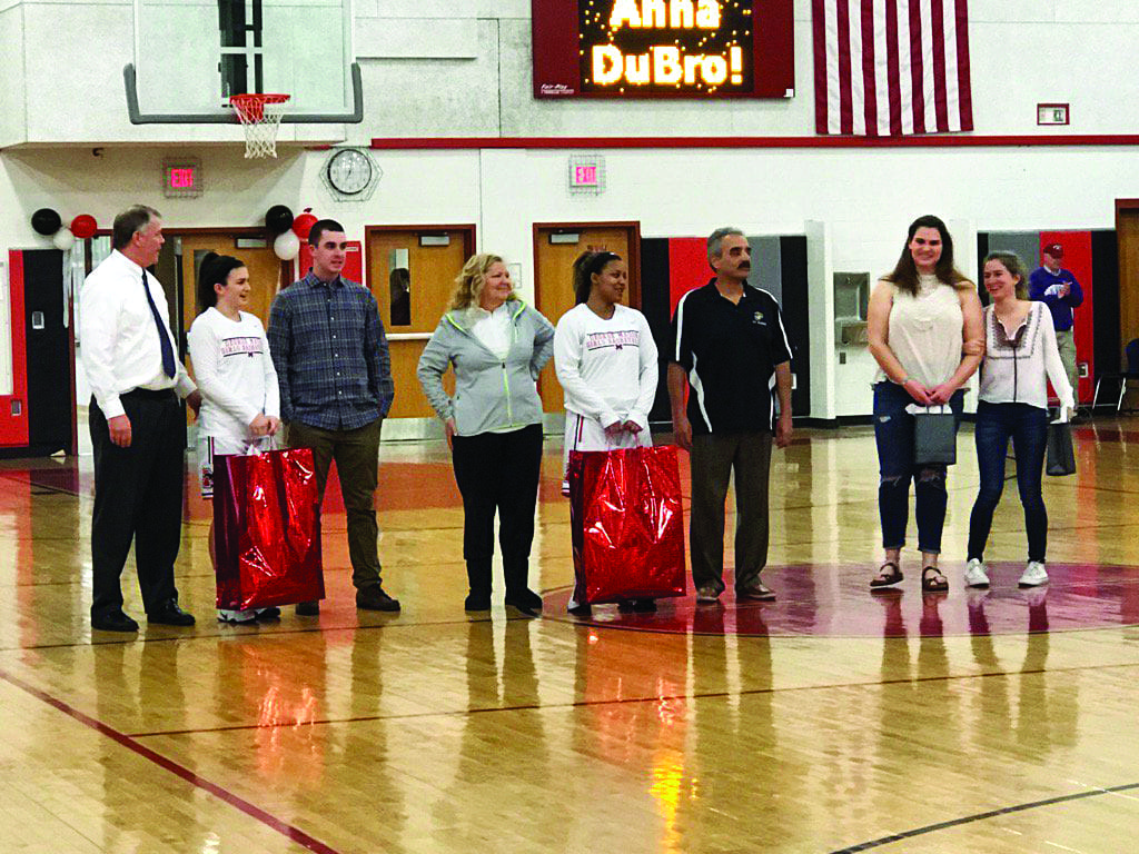 Recognized on senior night last week were George Mason High School girls basketball team members (left to right) Sarah Lubnow, with her dad and brother, and Kenya Bliss with her parents. Also recognized were team senior managers Maeve Donnelly and Anna DuBro. (Photos: Bryan Harris)