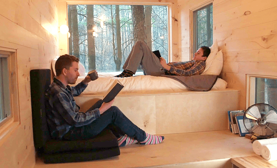 F.C. NATIVE AND GEORGE Mason High School alum Pete Davis (right) and business partner Jon Staff relax in a tiny house, part of the duo's fleet in their startup, Getaway. (Courtesy Photo)