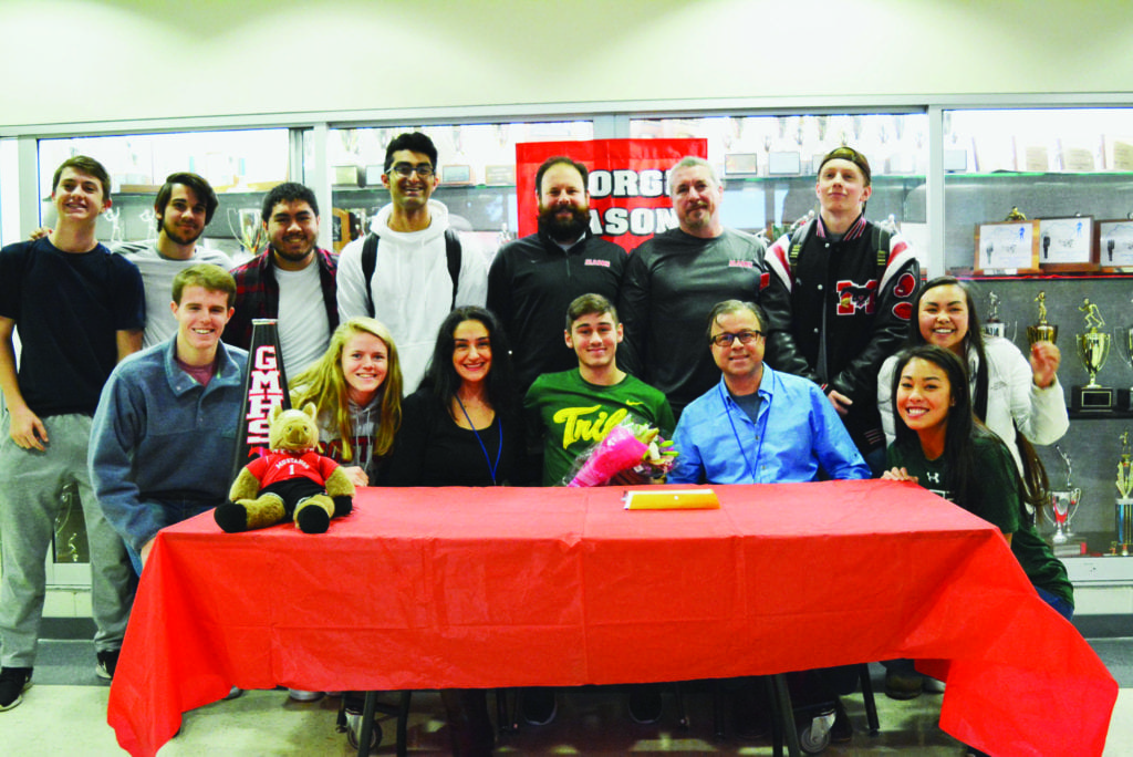 Derin Kokuuslu (center, in green) with friends and family after signing letter of intent to play soccer at the College of William and Mary (Photo: Carol Sly)