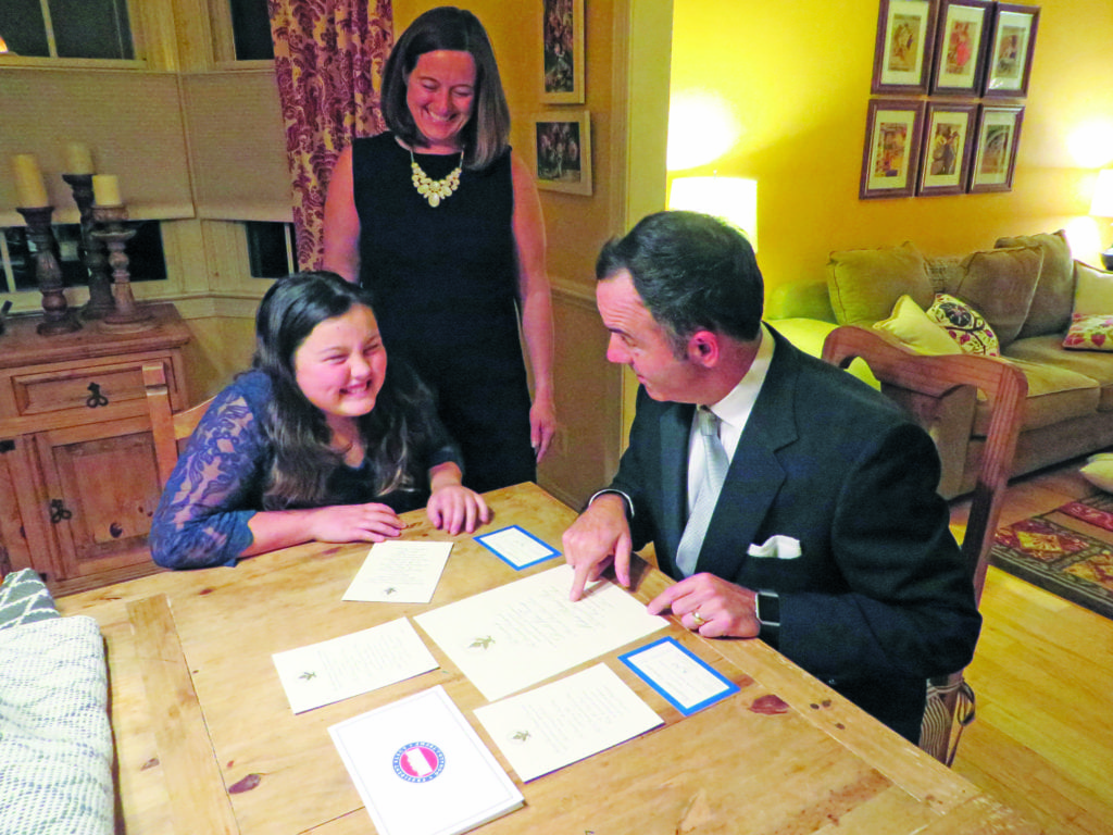 Madison, Jennifer and Matt Keelen of Falls Church review official invitations to the Donald Trump Presidential Inauguration this Friday. (Photo: News-Press)
