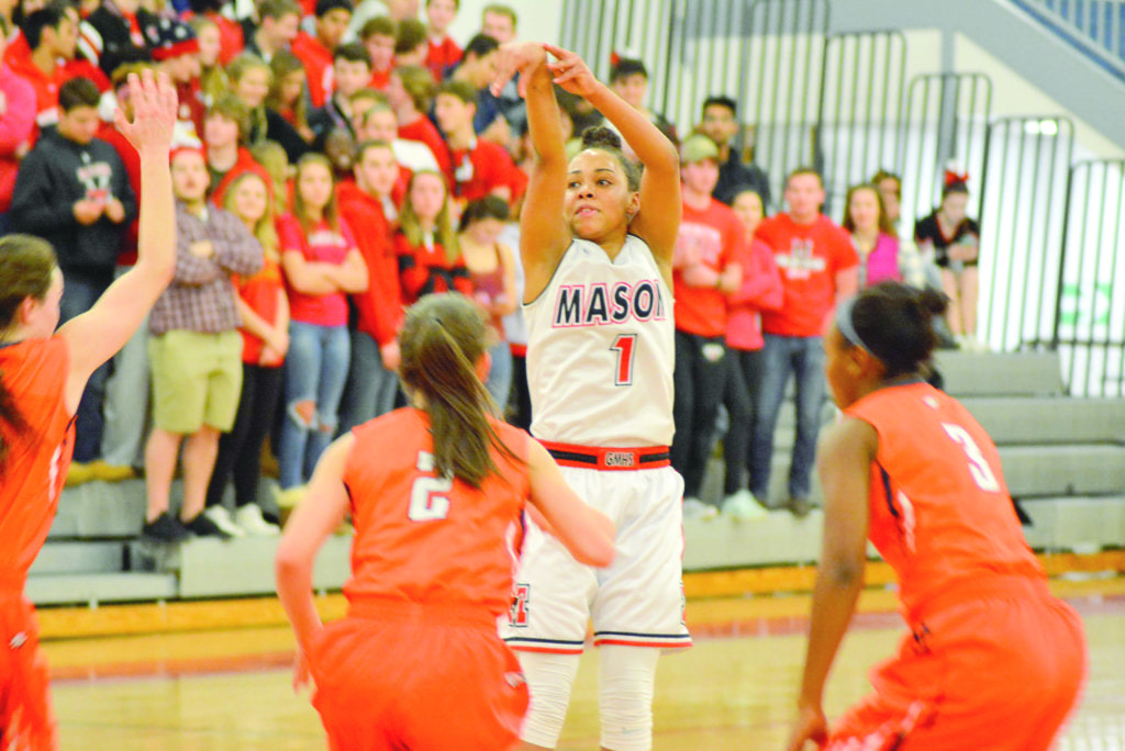 George Mason High School's Nicole Bloomgarden follows through on a 3-pointer during the Mustangs' 68–39 win against Clarke County. (Photo: Carol Sly)