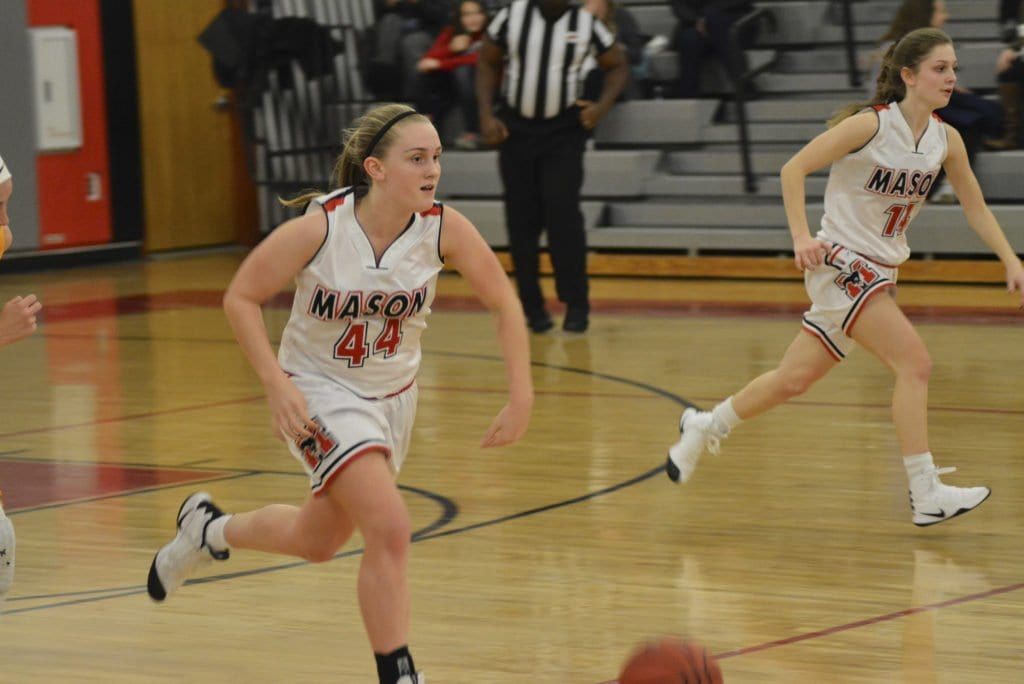 Maddie Lacroix (with ball) and Lizzy Dodge race up the court.(Photo: Carol Sly)