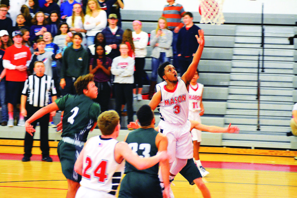 GEORGE MASON HIGH'S Briuk Teshome drives for a lay up during Mason's 64-41 loss against William Monroe Tuesday. (Photo: Carol Sly)