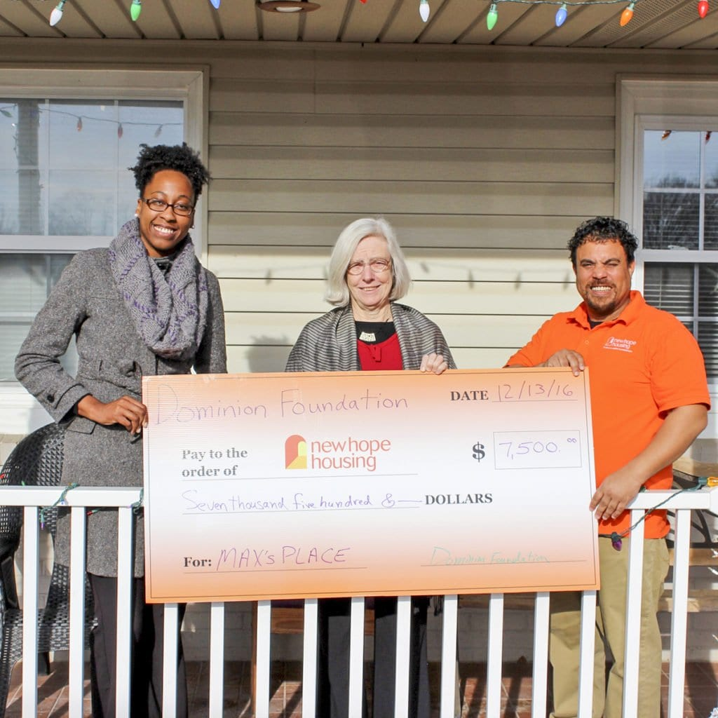 NEW HOPE HOUSING IN ALEXANDRIA recently received a $7,500 grant from the Dominion Foundation, which is the charitable arm of Dominion Resources. Akira Brown, Alexandria Housing first case manager, Pamela Michell, executive director of New Hope Housing and Lance Flowers, outreach counselor for Max's Place, are seen here holding the big check from the Dominion Foundation. Michell said that the organization has moved 339 individuals from homelessness to housing in 2016. (Photo: Courtesy of Sara Hunt)