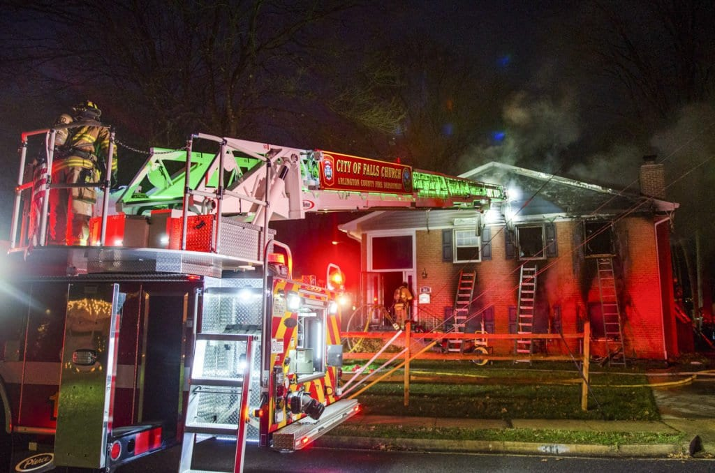 CITY OF FALLS CHURCH fIREFIGHTERS battle a blaze on Timber Lane last Saturday evening. The house fire caused $300,000 in damages and resulted in the home being condemned. (Photo: J. Michael Whalen)