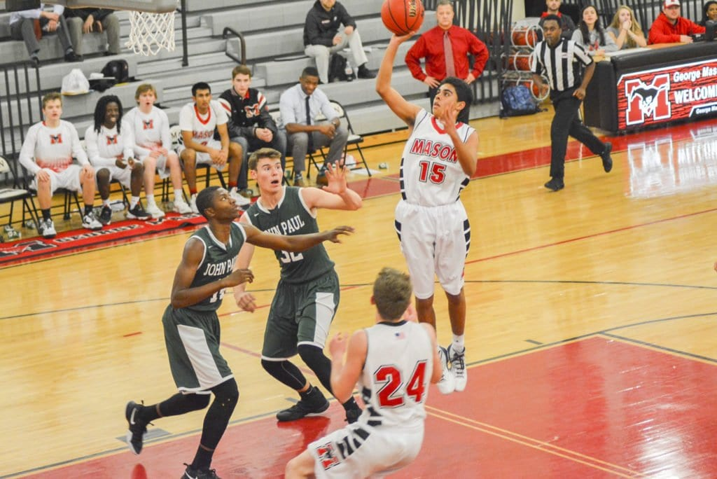 MASON'S MAX ASHTON goes for two points during the Mustangs' recent win. (Photo: Carol Sly)