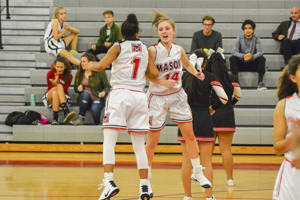 MASON JUNIOR GUARD NICOLE BLOOMGARDEN (right) bumps teammate Lizzy Dodge after being introduced during a recent win against Strasburg High School. (Photo: Carol Sly)