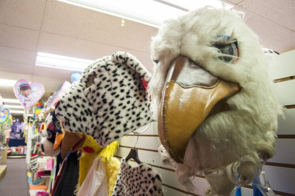 SOME OF THE COSTUMES at Economy Party Supplies and Costumes hang on the wall. Lahey says that the costumes are on sale for 40 percent of what they would usually cost. (Photo: Drew Costley/News-Press)