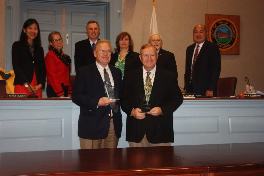 MEMBERS OF THE Falls Church City Council posed with the City's Planning Director Jim Snyder and Zoning Administrator John Boyle at Monday's Council meeting.