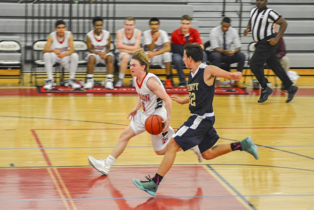 MASON'S DAVID MILLER drives down the court during the Mustangs' recent win over Trinity School at Meadow View. The Mustangs will take a 2-0 record to Mount Vernon High School on Thursday, Dec. 8. (Photo: Carol Sly)