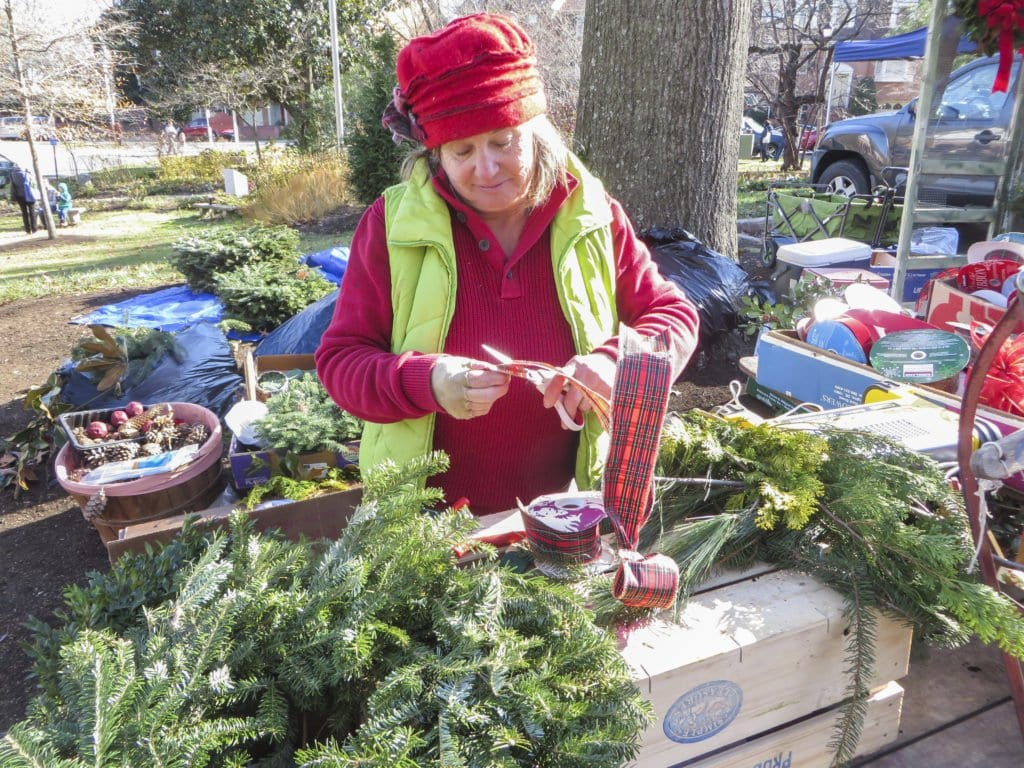 RHONDA STEVENSON assembles a wreath at the City of Falls Church's Holiday Farmers Market, which opened on Saturday, Dec. 3. The Holiday Farmers Market's remaining dates are December 10 and 17. (Photo: Patricia Leslie/News-Press)