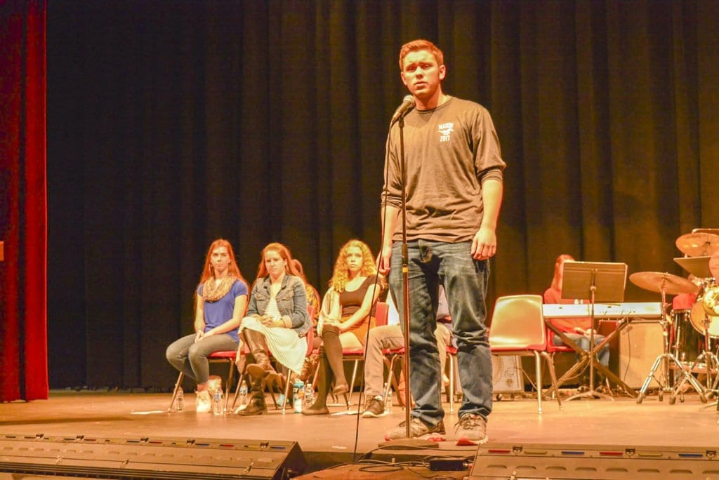GEORGE MASON HIGH SCHOOL SENIOR Carter Findley performs a poem during the school's Poetry Out Loud competition. He won the school competition. (Photo: Carol Sly)