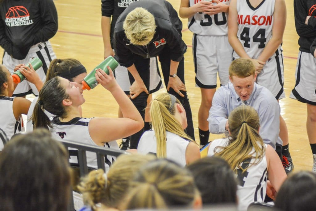 GEORGE MASON HIGH SCHOOL girls varsity basketball head coach Mike Gilroy talks to his team during a timeout during a home game last season. (Photo: Carol Sly)