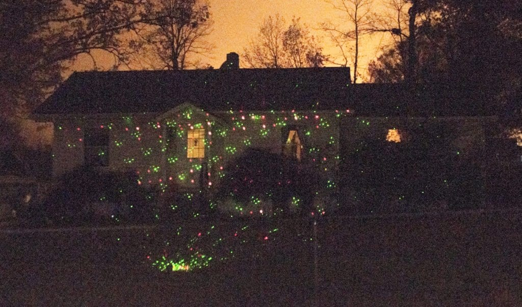 THE STAR SHOWER LASER LIGHT, seen being used on the Northern Virginia home above, has been a popular alternative to string lights. (Photo: Drew Costley/News-Press)