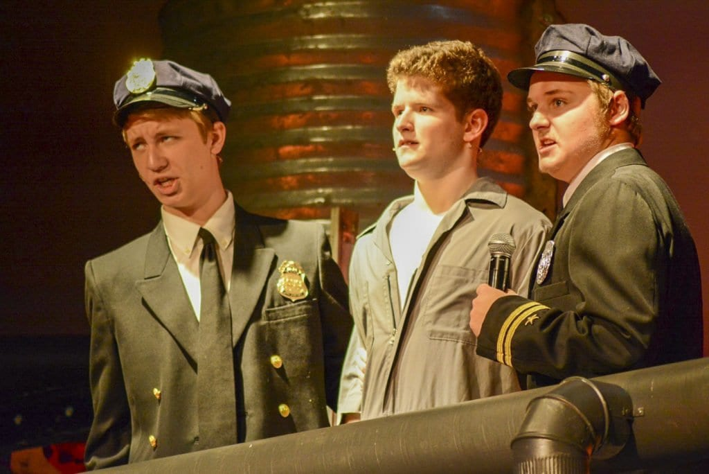 "Mason students Charlie Boland, Alec Reusch and Will Langan perform in ""Urinetown: The Musical."" (Photo: Carol Sly)"