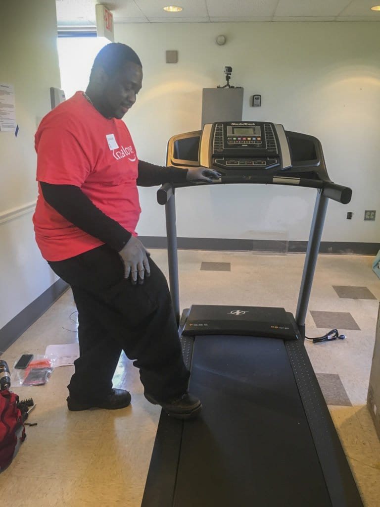 THROUGH AMAZON'S LOCAL LOVE program, Homestretch got two new treadmills as part of a new health and wellness center they opened up. (Courtesy Photo)