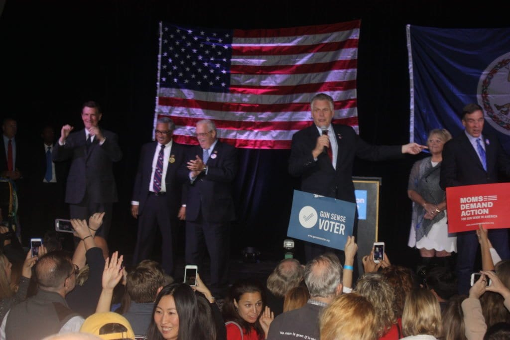 VIRGINIA GOVERNOR Terry McAuliffe (center) took to the stage at Falls Church's State Theatre Tuesday night to tell 400 Democratic faithful that Hillary Clinton had carried the Commonwealth of Virginia in the presidential election. On the left are U.S. Reps Donald Beyer, Gerry Connolly and Bobby Scott. (Photo: News-Press)