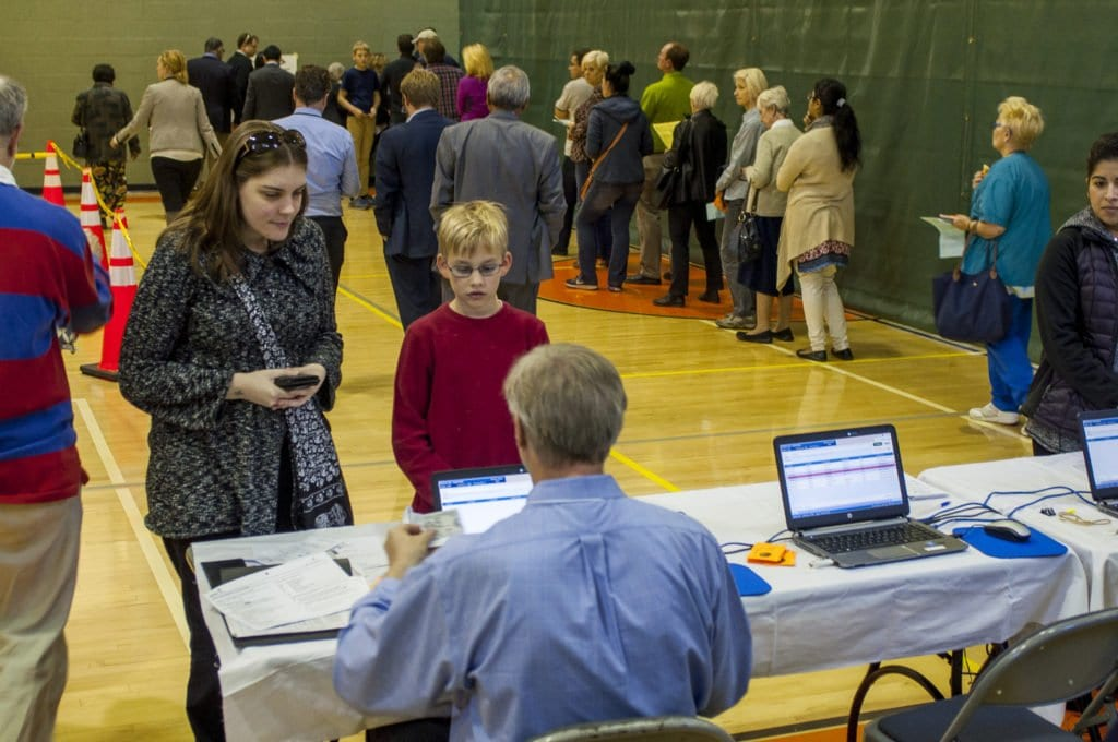 Voters check-in at the Community Center, one of three polling locations in the City of Falls Church. (Photo: Drew Costley)