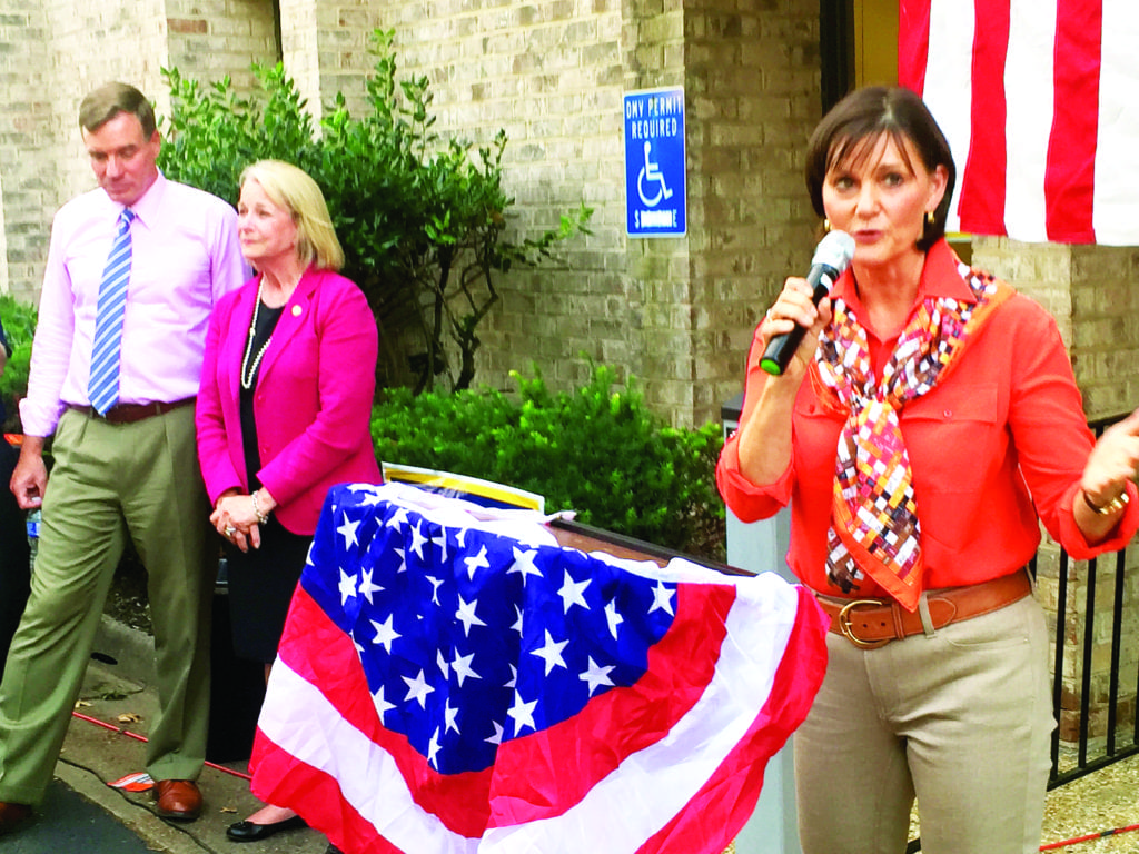 DEMOCRAT LUANN BENNETT (right), challenging incumbent Republican Barbara Comstock in the 10th District that runs from McLean to western Loudoun County, is shown at an event at her campaign office recently, accompanied by U.S. Senator Mark Warner and State Del. Kathleen Murphy (left). (Photo: News-Press)