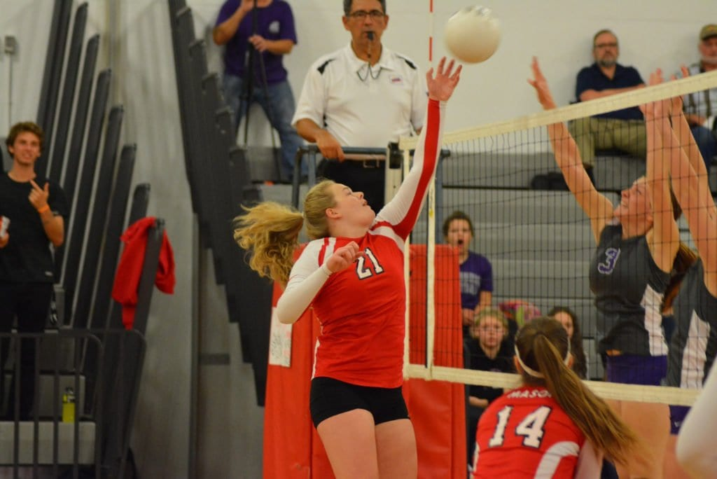 SOPHOMORE HITTER McKenzie Brady tips the ball over the net during the Mustangs' 3-0 win over Strasburg High School in the Conference 35 tournament. The Mustangs take on Clarke County in the tourney final tonight. (Photo: Carol Sly)