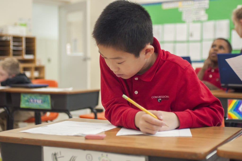 A CONGRESSIONAL SCHOOL STUDENT works on a math assignment in one of his classes on Friday, Oct. 28. The school recently changed its name from the Congressional Schools of Virginia to just Congressional School. (Photo: Drew Costley/News-Press)
