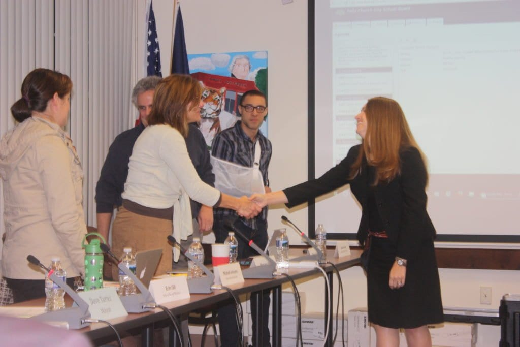 FALLS CHURCH SCHOOLS' new legal counsel, Patricia Minson (right) greets members of the School Board at Tuesday's meeting, including (left to right) Erin Gill, Margaret Ward, Phil Reitinger and student member Gabriel Perez  (Photo: News-Press)