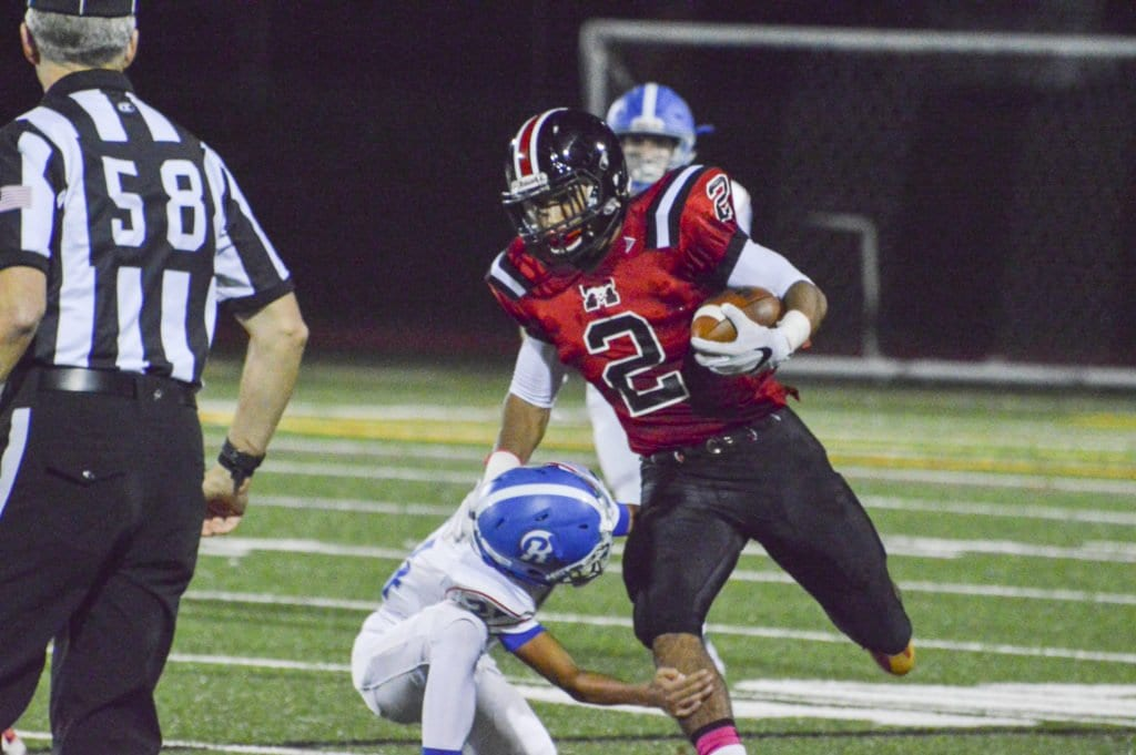 MASON SENIOR DUSTIN GREEN shrugs off a would be tackler in the Mustangs' game against Riverside. He scored his longest rushing touchdown of the season in the Mustangs' latest game against Warren County, which they lost. (Photo: Courtesy of FCCPS Photo/Courtesy John Roou)