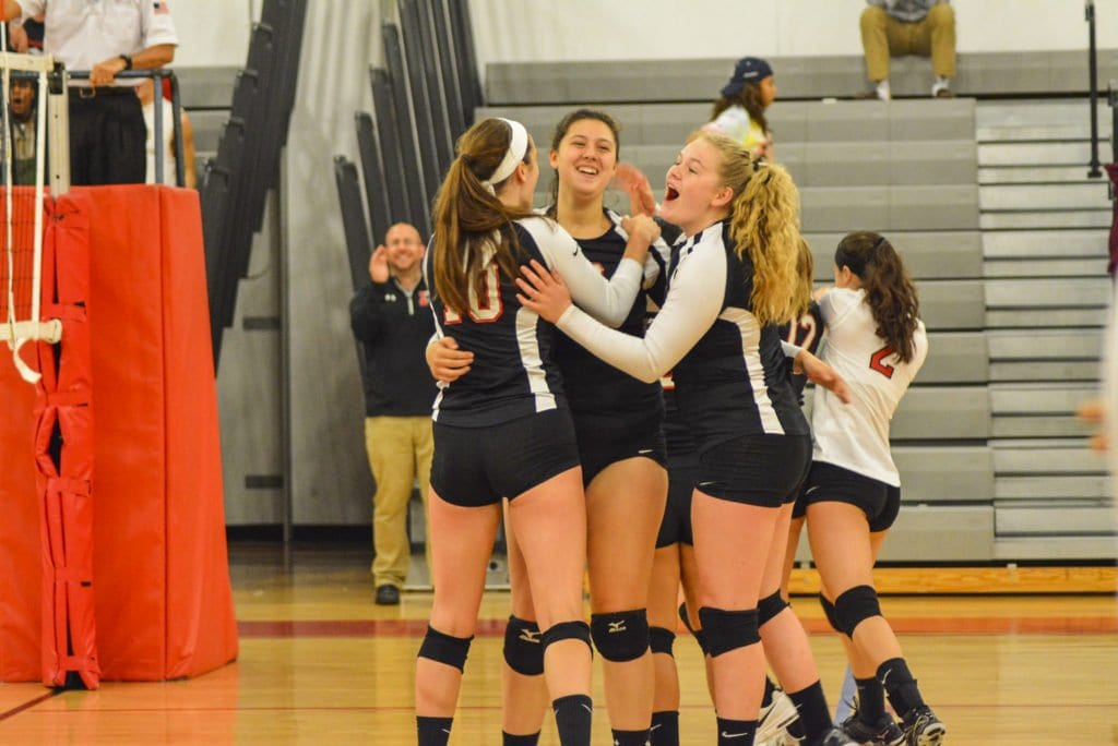 THE MUSTANGS VOLLEYBALL TEAM celebrates with a group hug after a recent win over Warren County High School. The Mustangs are 12-2 on the season and have only lost two sets in the month of October. Their next game is tonight against Madison County High School at home. (Photo: Carol Sly)