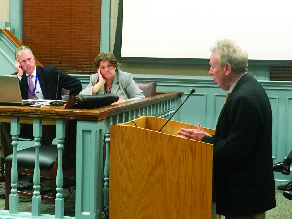 RICHARD GOFF (right), director of the City of Falls Church's Economic Development Office, made the case for a significant expansion of the City's tax abatement incentive for office development to the City Council Tuesday night. City Manager Wyatt Shields (far left) and City Attorney Carol McCoskie look on. (Photo: News-Press)