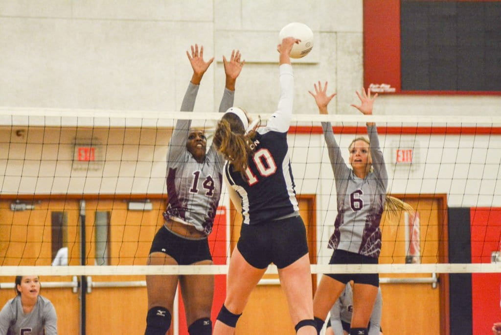 MASON SENIOR KATE KARSTENS hits the ball between two Warren County High School players during the Mustangs' recent win over the Wildcats on Thursday, Oct. 6. Mason also topped William Monroe High School this week. (Photo: Carol Sly)