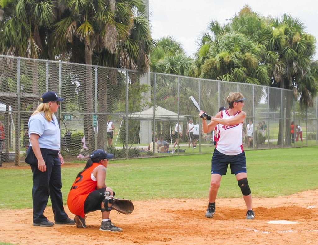 KAREN NAVARRO (RIGHT) TAKES AN AT BAT during a softball game after receiving a total ankle replacement from Falls Church's Dr. Steven Neufeld. She said that the procedure made her ankle feel as good as it did prior to when she sprained it. (Photo: Courtesy of Karen Navarro)