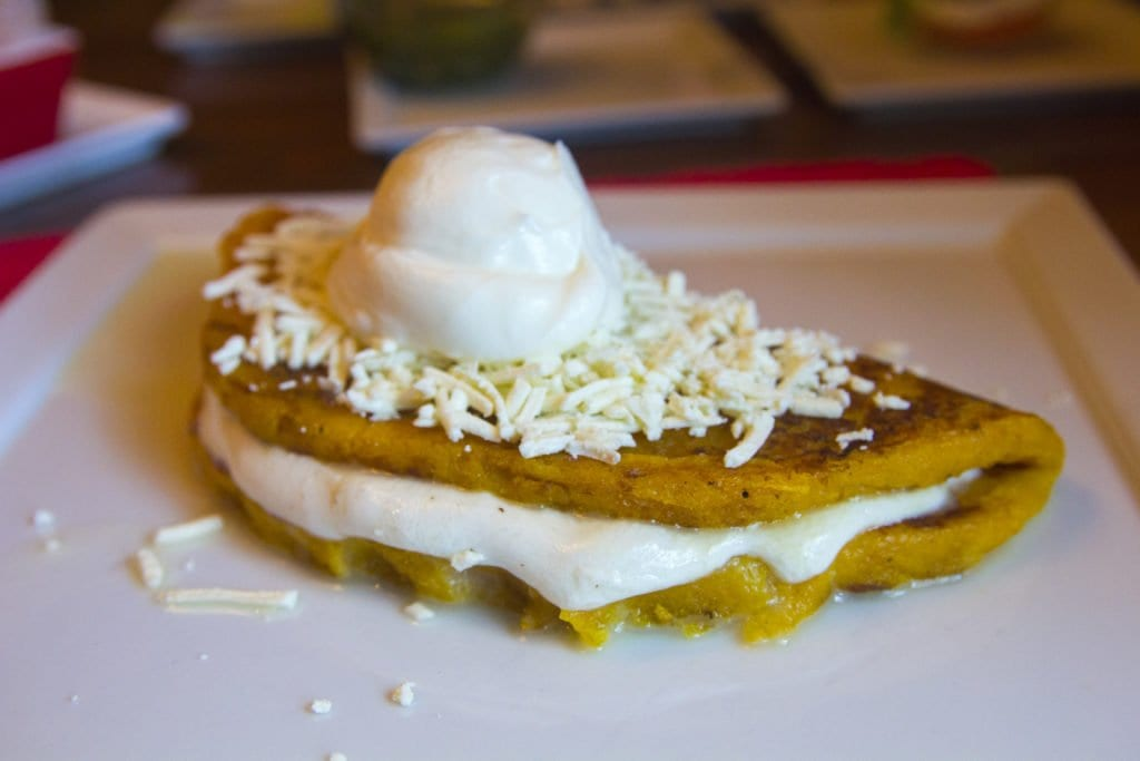 NOW ON THE MENU AT La Caraqueña, soon-to-be Falls Church's newest food obsession: cachapas, a popular Venezuelan roadside food stuffing a corn pancake with cheese.