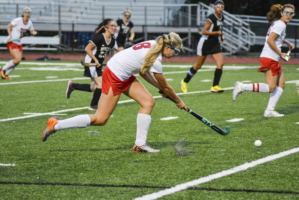 MASON JUNIOR MIDFIELDER LYDIA GRUND crosses a ball to the Mustang offense during its recent win over School Without Walls. (Photo: Carol Sly)