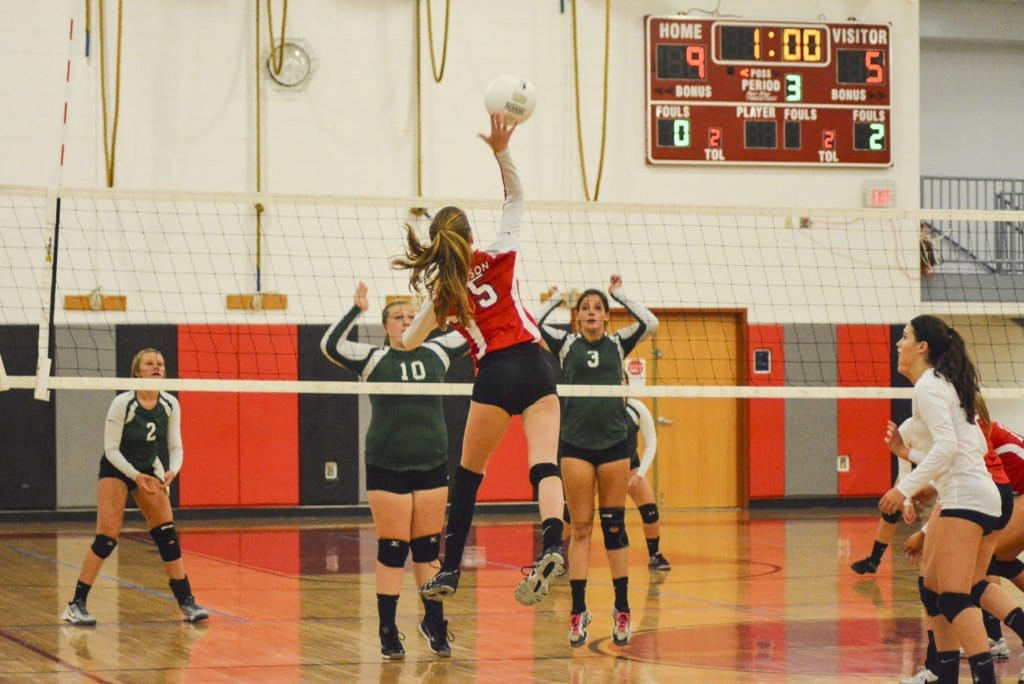 MASON SOPHOMORE RILEY RUYAK leaps up to make a play during the Mustangs' match against William Monroe High School. (Photo: Carol Sly)
