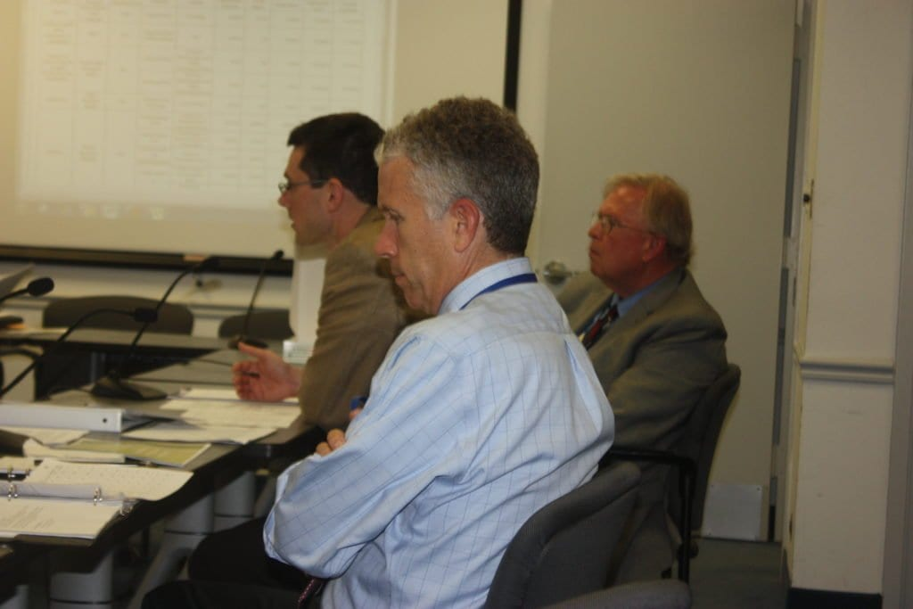 FALLS CHURCH'S PRINCIPAL Planner Paul Stoddard (center) was flanked by City Manager Wyatt Shields (foreground) and Planning Director Jim Snyder (background) presenting findings on his department's visioning efforts for the City at a City Council work session Monday night. (Photo: News-Press).
